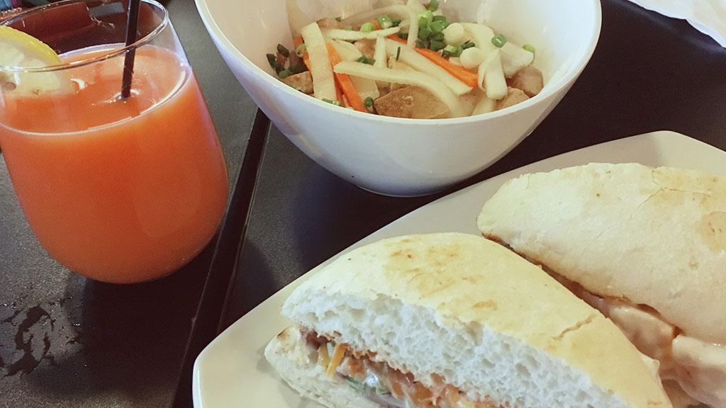Strawberry Mimosa, Marinated Tofu Bowl, and Salmon Tinaktak Sandwich at Pika's Cafe